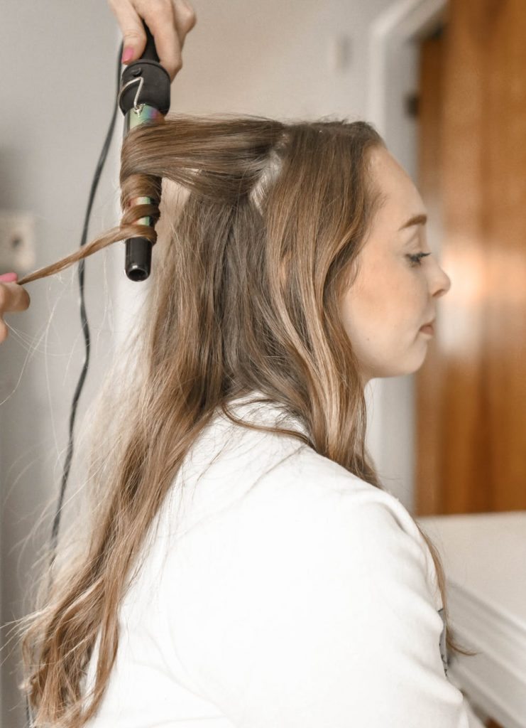 woman getting her hair done in a salon