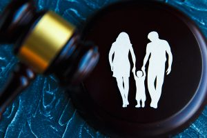 Cutout family image and a gavel. Family Law concept