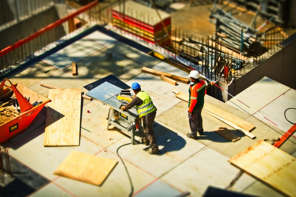 Construction workers considering installing water stop systems