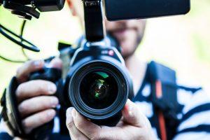 Sydney wedding photographer holding a camera