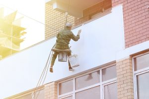 Worker offering Melbourne painting service