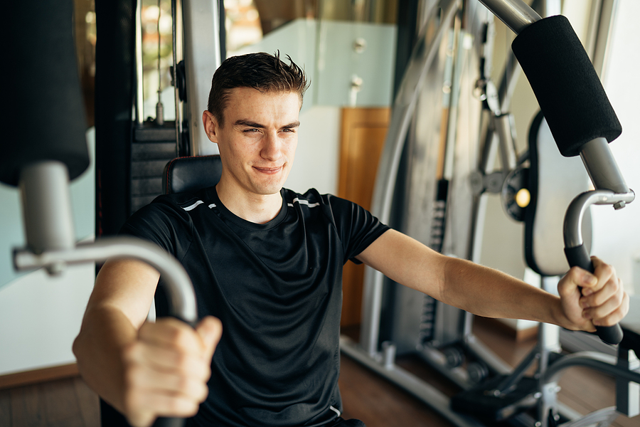 Man using an exercise machine at home